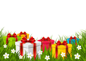 Gift boxes on green grass