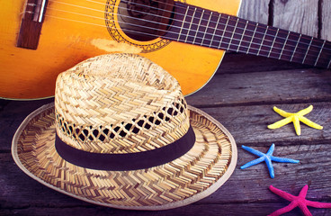 Acoustic guitar star hat and starfish