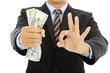 businessman grasp us dollars with ok gesture
