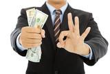 businessman grasp us dollars with ok gesture poster