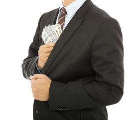 businessman putting money in the pocket with white background