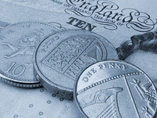 British coins on banknote
