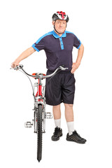 Healthy mature man pushing a bike