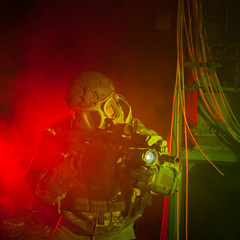 Special forces soldier with gas mask during the night mission