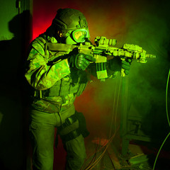 Special forces soldier with gas mask during the night mission (r