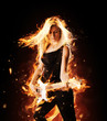 Burning girl with flaming guitar on black background