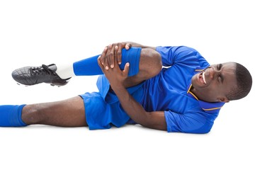 Injured football player lying on the ground