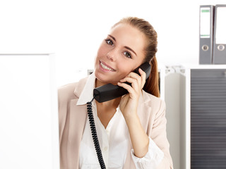 Female office assistant has a call