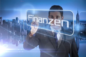 Businessman presenting the word finance in german