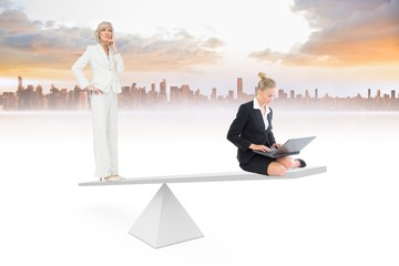 White scales weighing two businesswomen