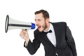 Geeky businessman shouting through megaphone