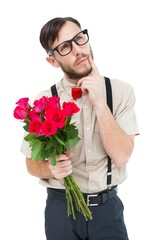 Geeky hipster offering bunch of roses
