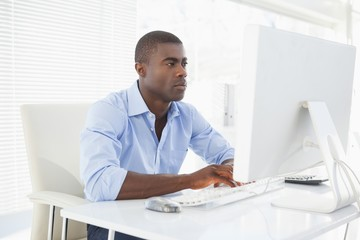 Focused businessman working at his desk
