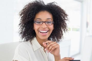 Pretty casual businesswoman working at desk