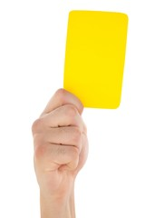 Hand holding yellow card up
