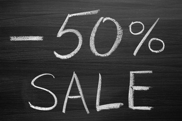 50-percent sale title written with a chalk on the blackboard