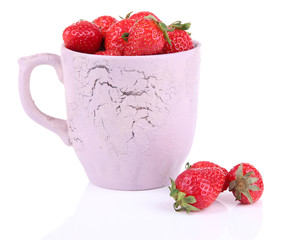 Ripe sweet strawberries in color mug isolated on white