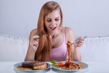 Girl suffering from bulimia eats dinner