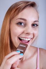 Skinny girl eats sweets