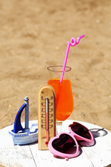 Thermometer in sand close-up