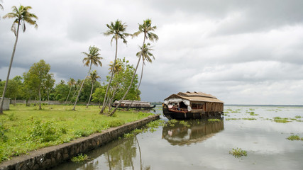houseboat in backwaters on a clody day