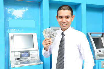 Asian businessman holding money - United States Dollars (USD)