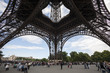 People and tourists visit Eiffel Tower in Paris