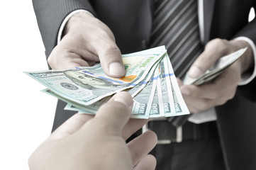Hands giving & receiving money - United States Dollars (or USD)