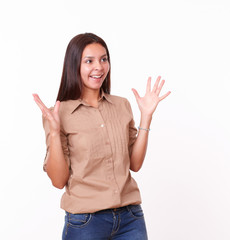 Surprised hispanic girl with brown blouse standing