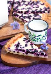 Homemade blueberry tart pie and milk