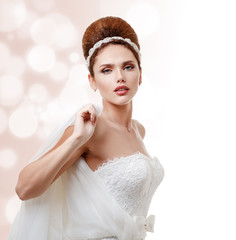 Beautiful bride in white wedding dress with hairstyle and makeup