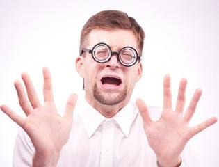 Afraid man in glasses