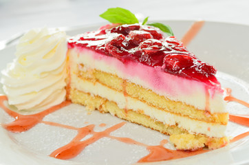 Delicious strawberry cheesecake with whipped cream
