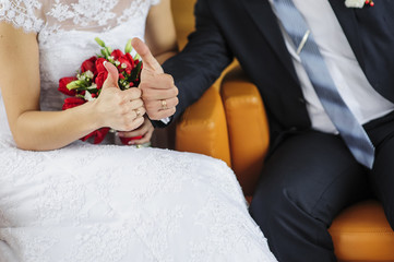 rings on hand dressed as a bride and groom