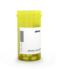 pills an pill bottle on white background