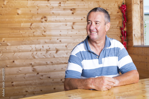 canvas print picture Man sitting on rustic table