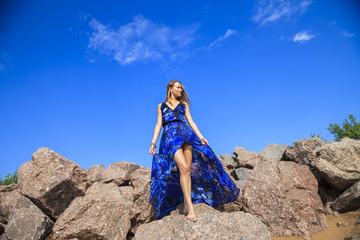 beautiful girl on the stone beach