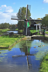 The  windmill is reflected in channel