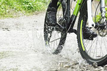 Mountain biker crossing creek
