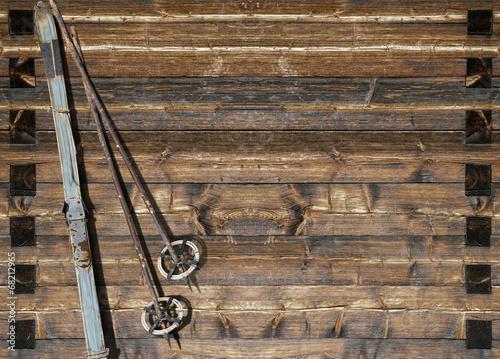 Plexiglas Wintersporten Historic blue ski with poles on wooden wall