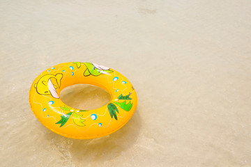 orange pool float, pool ring on the beach