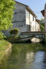 canal and bridge in the village, Abbadia Cerreto