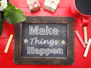 Make Things Happen on chalkboard on red table