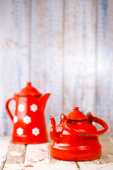 Red and white Enamel Tea Coffee Pots on wood