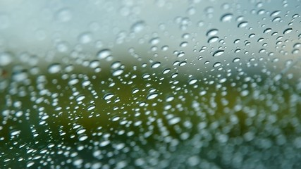 Raindrops on a car window,  windshield with wipers