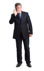 Businessman mischief gesture