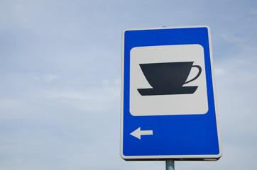 blue road sign show for coffee bar restaurant inn
