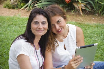 Two women working with tablet