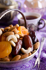 almonds, dried apricots, cashews, dates, lying in a metal bowl