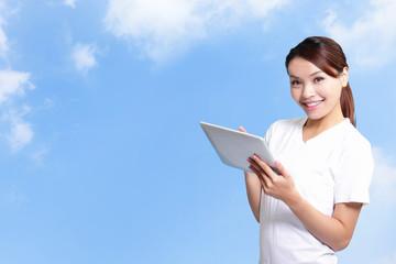 student woman using digital tablet